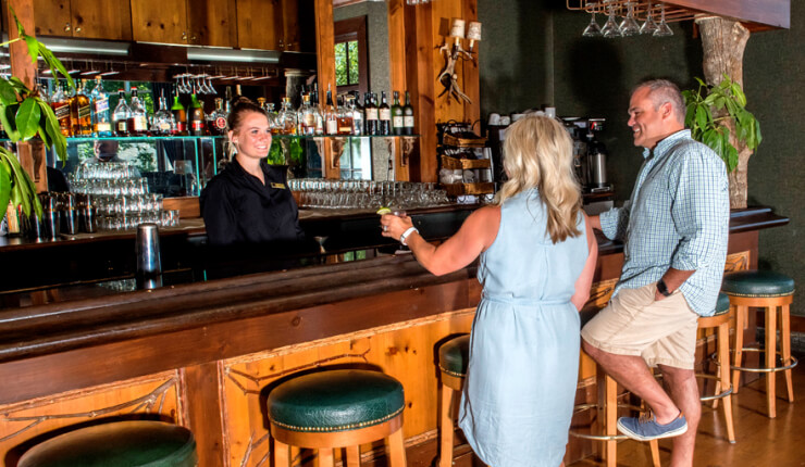 Couple ordering drinks from a female bartender at the Fireside Lounge of Brasstown Valley Resort & Spa in the North Georgia mountains.